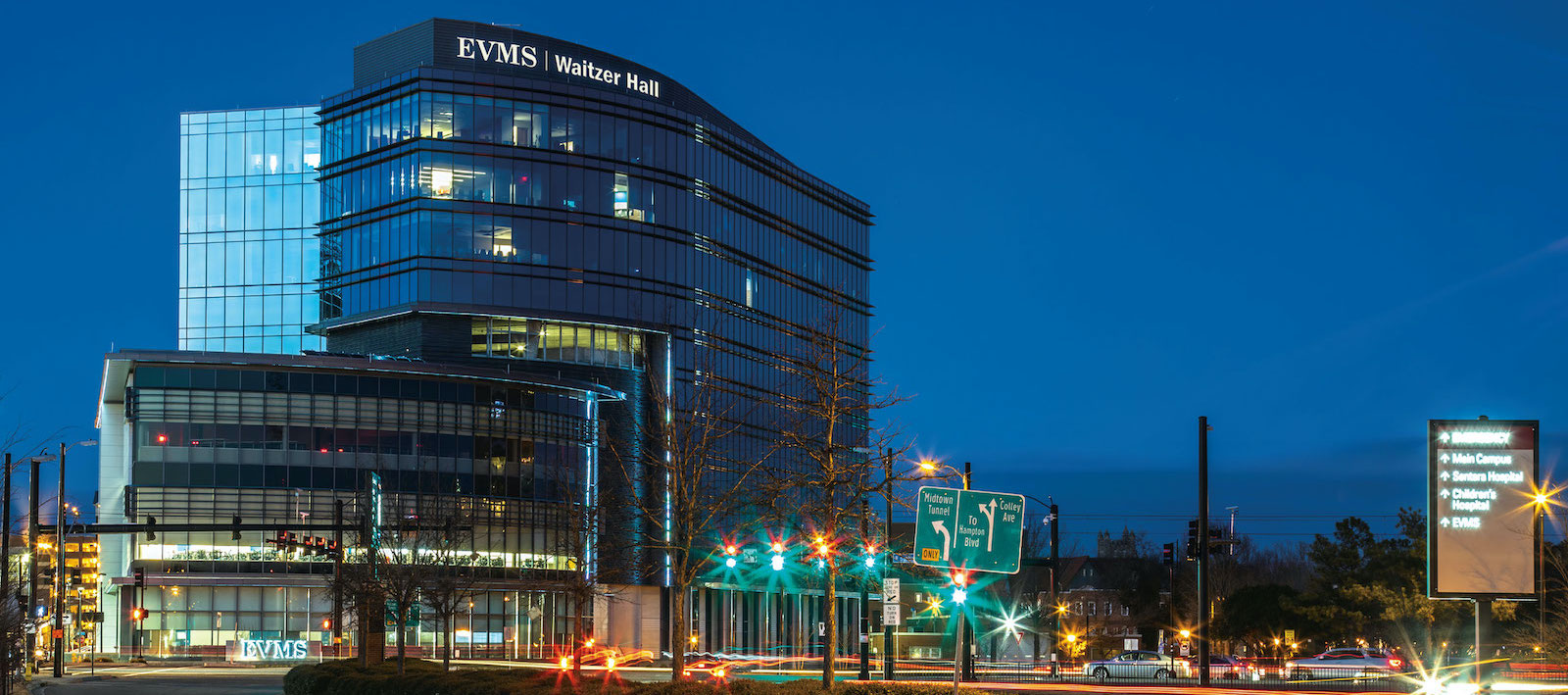 Nighttime view of EVMS' newest building, Waitzer Hall. The building is situated at the southeast corner of campus overlooking the busy intersection of Brambleton and Colley avenues.