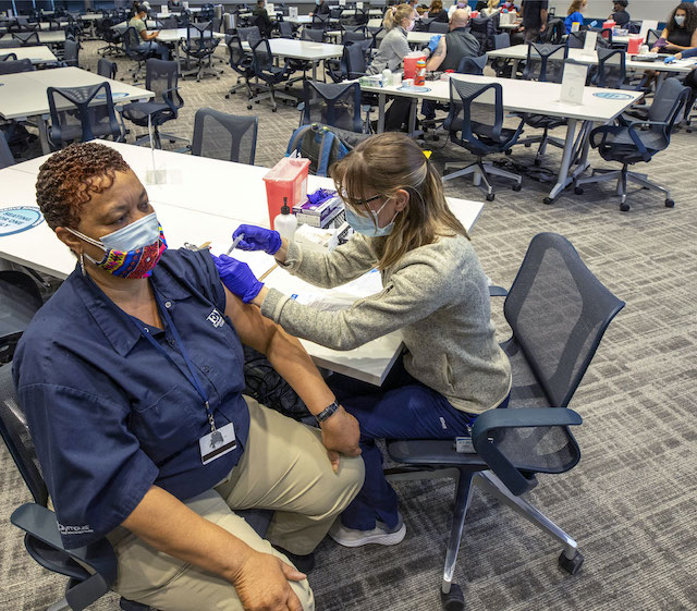 An EVMS employee receiving a vaccination