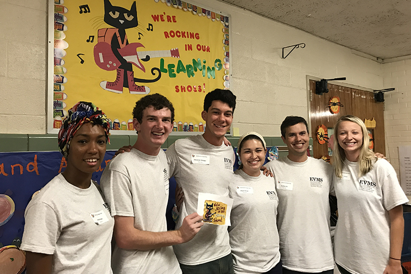 During Community Impact Day, 259 students volunteered at local school.
