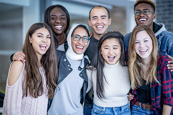A diverse group of students poses for a photo.