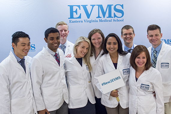 A group of new EVMS students pose for a photo during new student orientation.