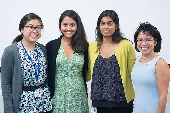 Dr. Cynthia Romero stands with three Schroeder Center-Brock Institute Summer fellows.