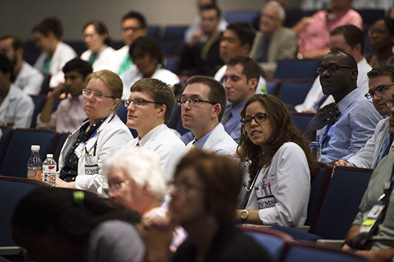Students and faculty listen during Grand Rounds.