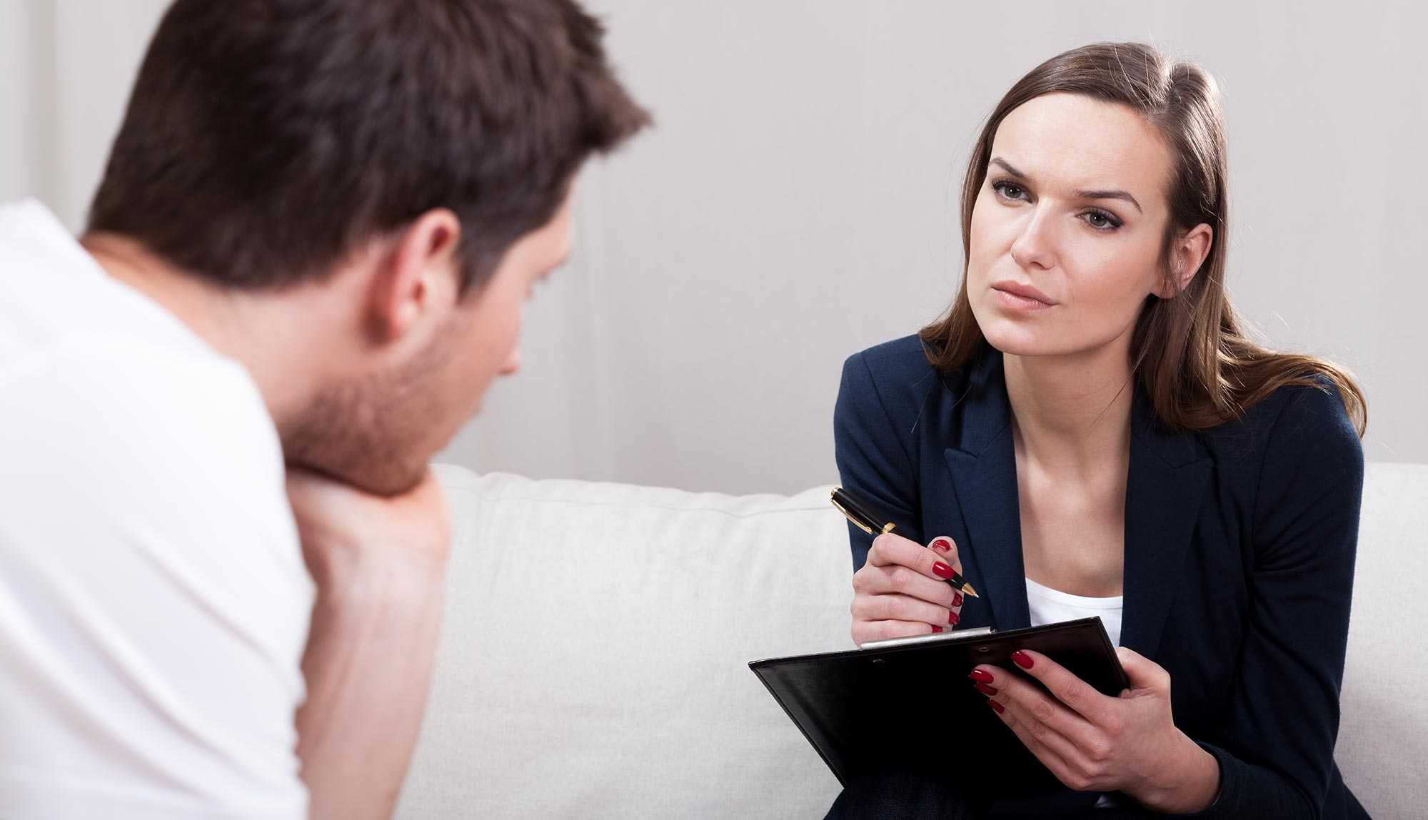 A clinical psychologist talks with a patient.
