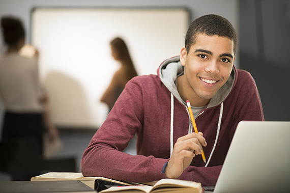 Image of a student working on a computer