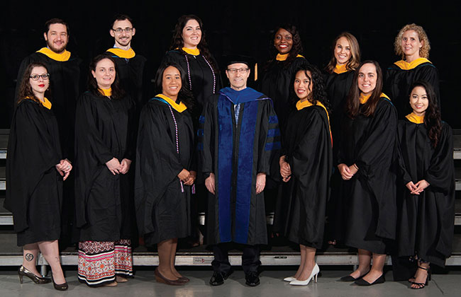 The inaugural Pathologists' Assistant graduating class poses for a graduation photo.