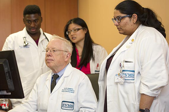 Dr. Patrick Haggerty and Infectious Disease fellows work together on examining patient cases.