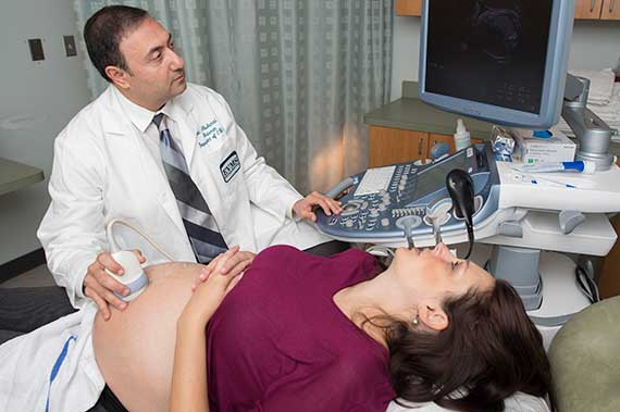 Dr. Alfred Abuhamad performs an ultrasound on a patient.