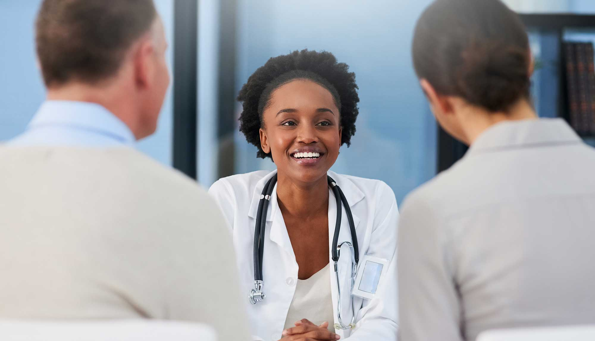 A reproductive endocrinologists consults with patients.