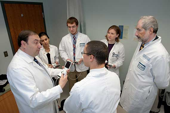 Drs. Abuhamad and Levitov with students.