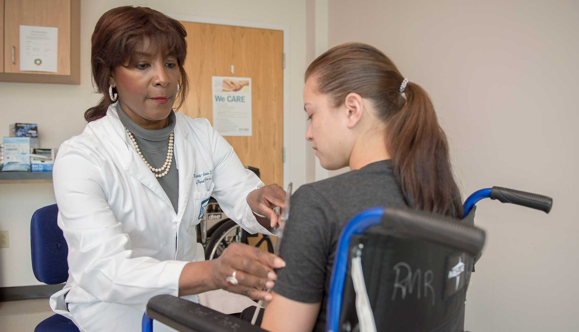 Dr. Beverly Roberts-Atwater examines a patient.