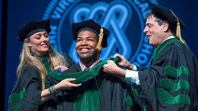 Graduate gets hooded