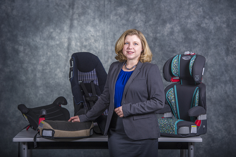 Dr. Kelli England with booster seats