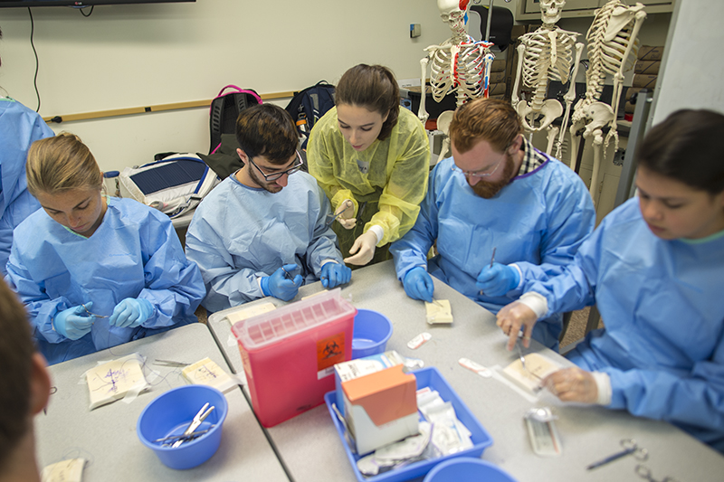 Surgical Assisting students recently hosted Suture Fest, where they tutor other students in the skills of suturing and tying along with scrubbing in, gowning and gloving.