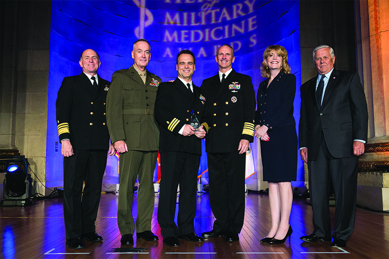 ‌Cmdr. Darian C. Rice, MD ('99), Chief of Cardiothoracic Anesthesia and the Director of the Anesthesia Residency Program at the Naval Medical Center Portsmouth, receiving the 2015 Hero of Military Medicine by the Center for Public-Private Partnerships at the Henry M. Jackson Foundation for the Advancement of Military Medicine, Inc. (HJF).