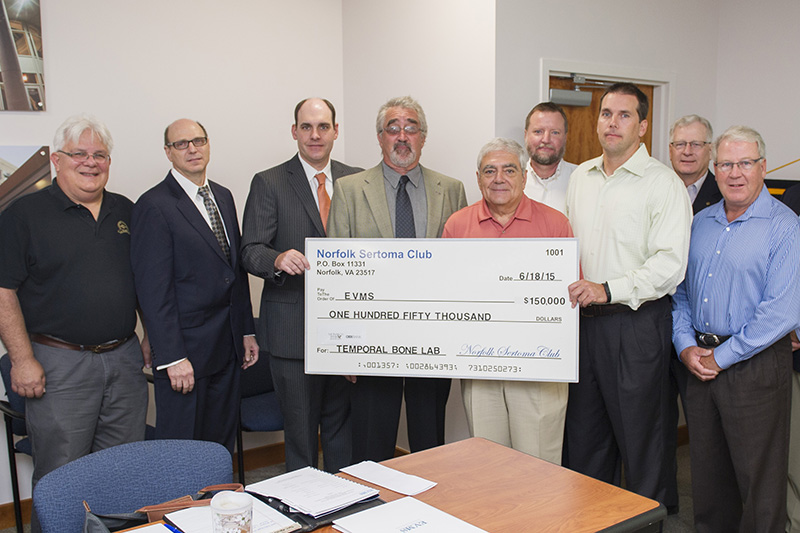 members of the Sertoma Club of Norfolk presented a check to EVMS for $150,000 to establish the Sertoma Club of Norfolk Temporal Bone Laboratory. It was the largest gift the Norfolk club has ever made to a nonprofit organization.