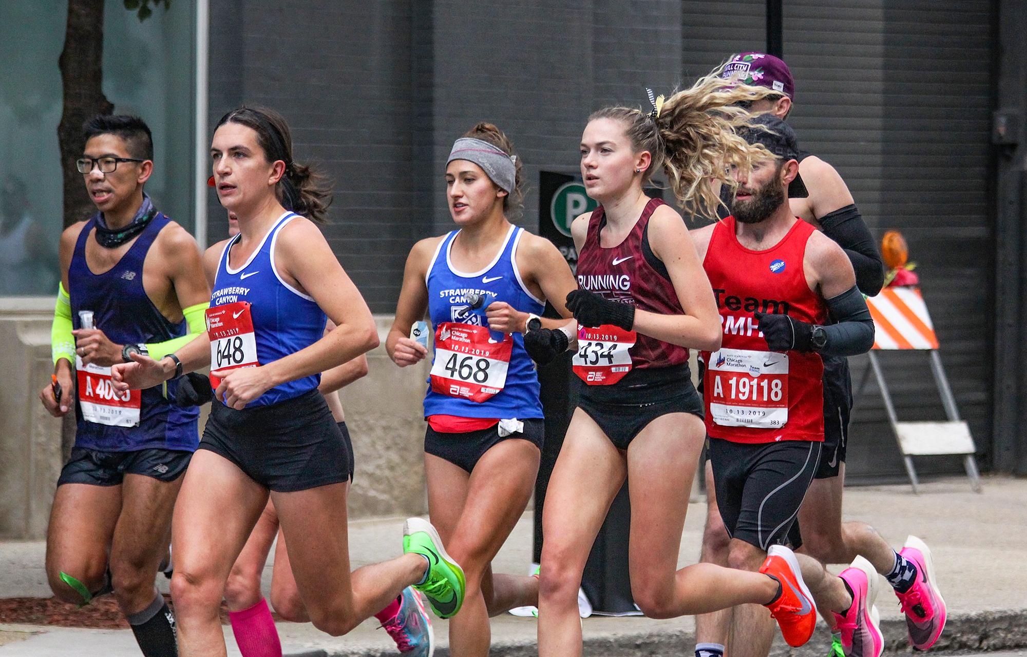 A still of Megan Cunningham running mid race.