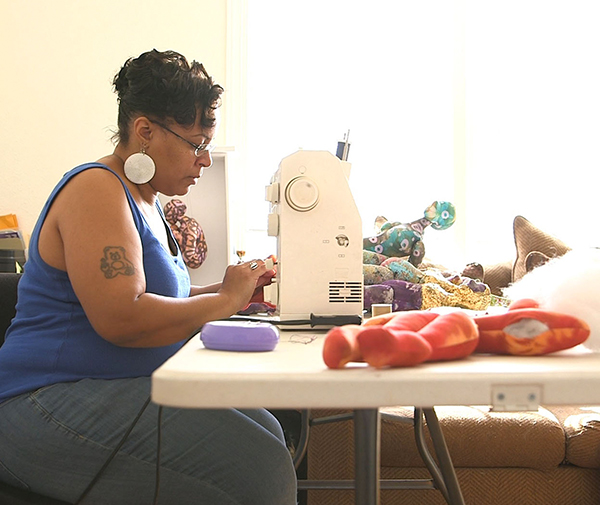 Artina Slaughter at the sewing machine she uses to create her artwork