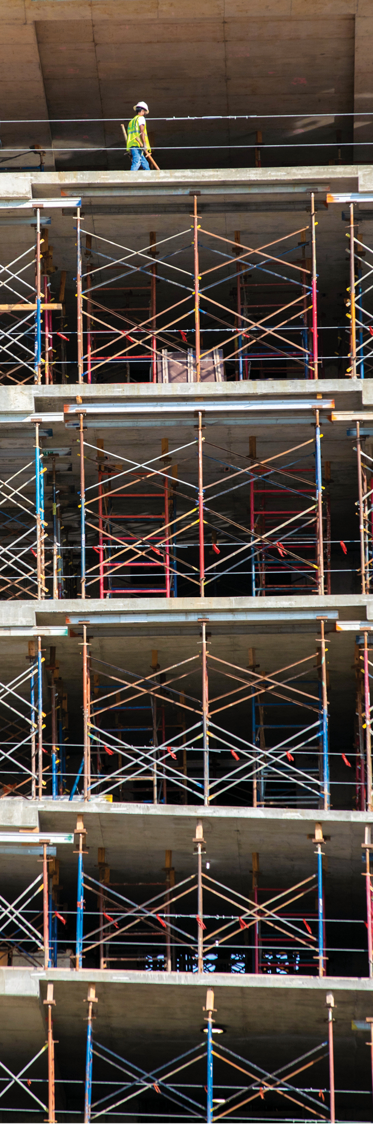 As concrete continues to cure, scaffolding supports several decks of flooring.