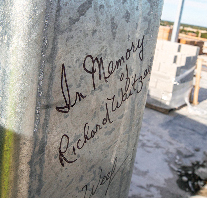 A pillar at the top of the building immortalizes Richard Waitzer, who died  in January 2019.