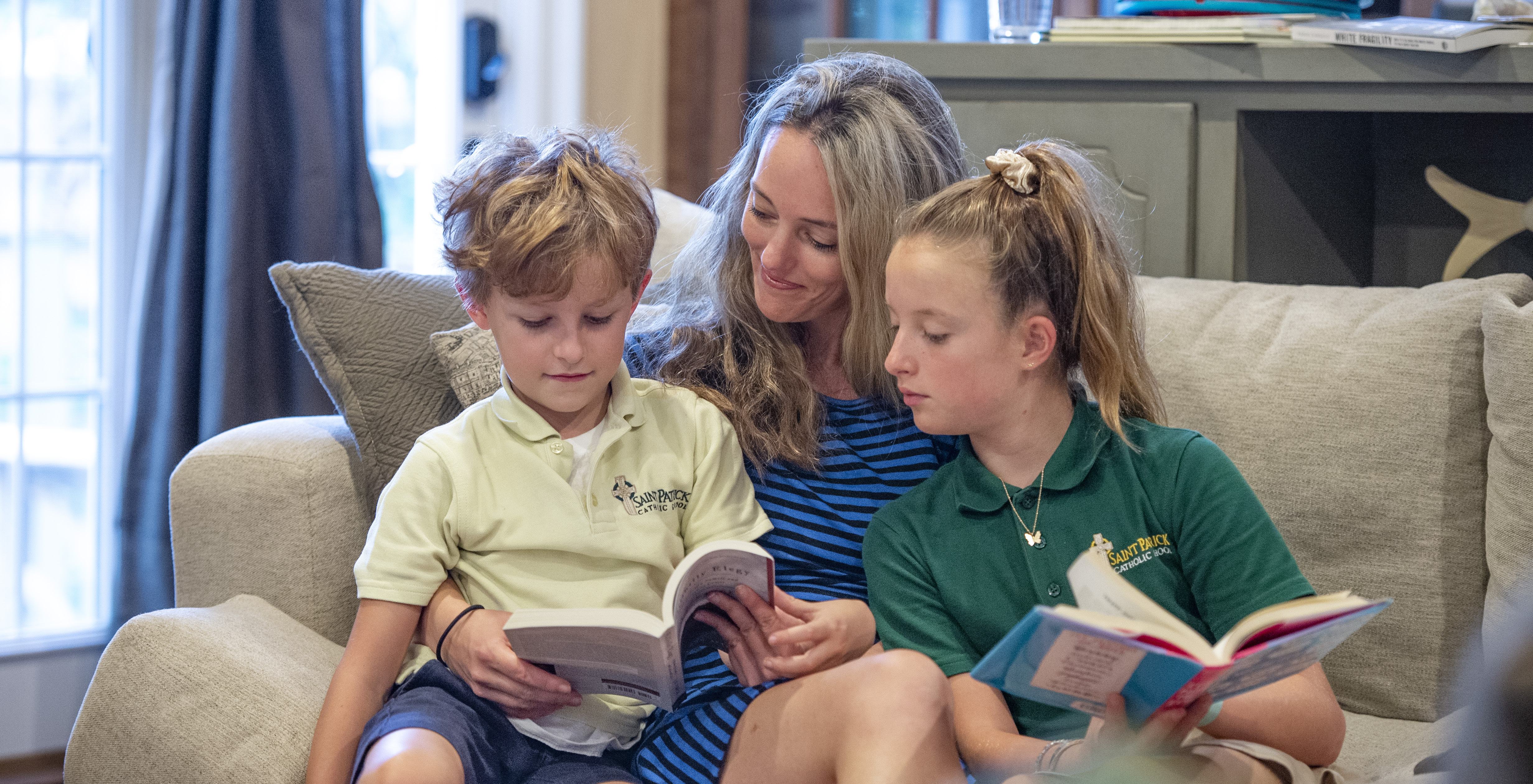Dr. Hooper reading with her two children in their family home.