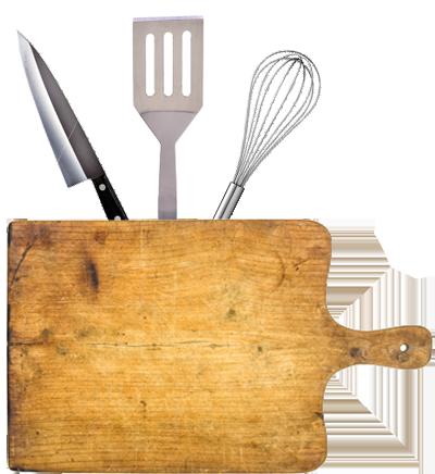 Cutting board with kitchen utensils