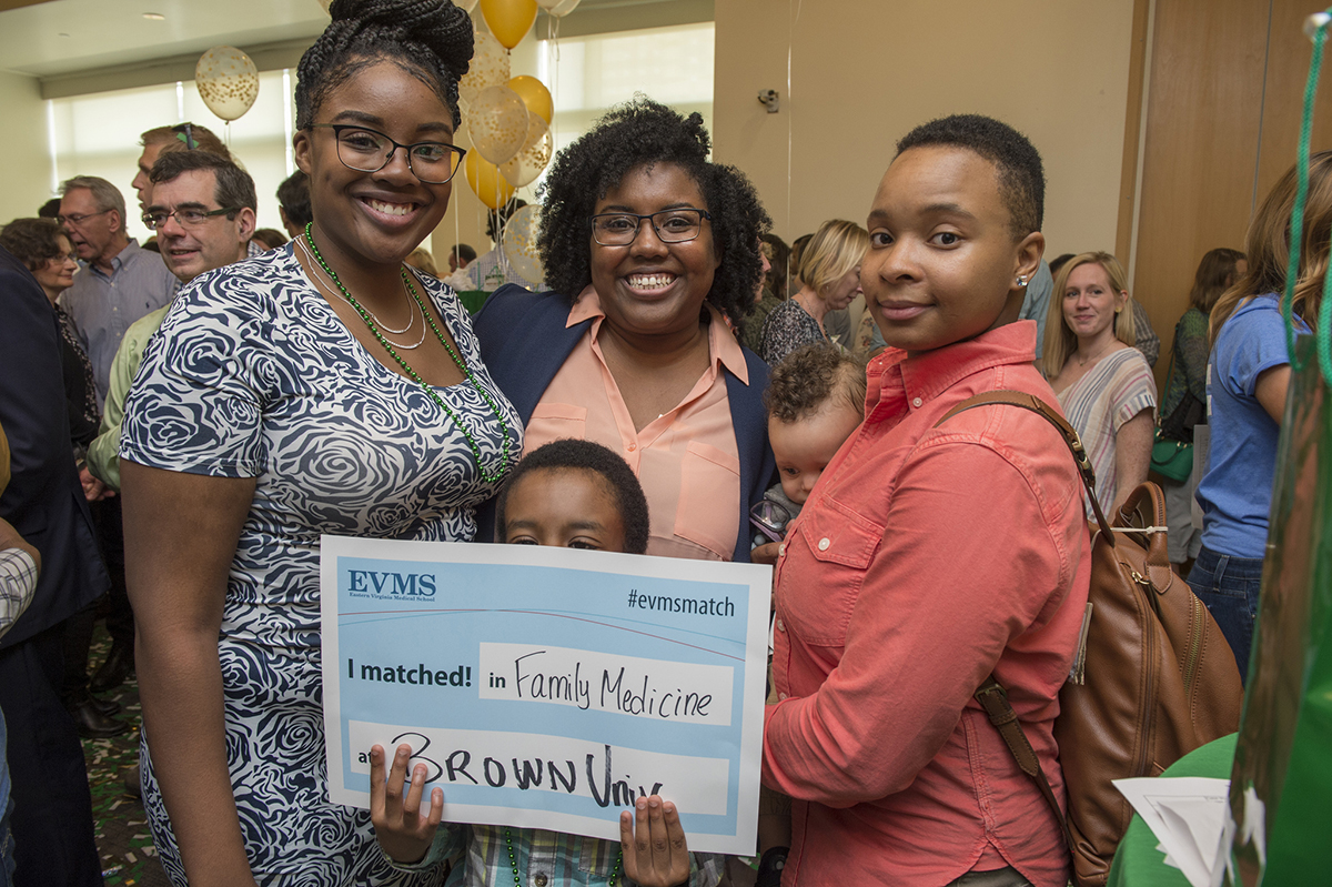 A fourth-year EVMS medical student celebrates with her family at Match Day 2019.