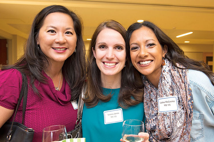 Hao Nguyen, MD (MD '05) , Valerie Jones, MD (MD '05) and Lipika McCauley, MD (MD '05), were happy to connect with fellow alumni at the POETS Reception.