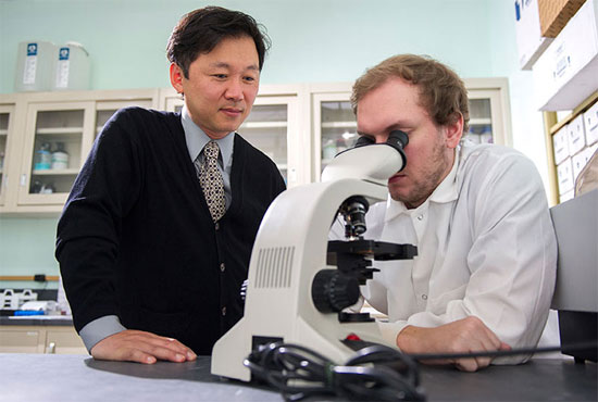Woong-Ki Kim, MD and Adam Filipowicz in the lab