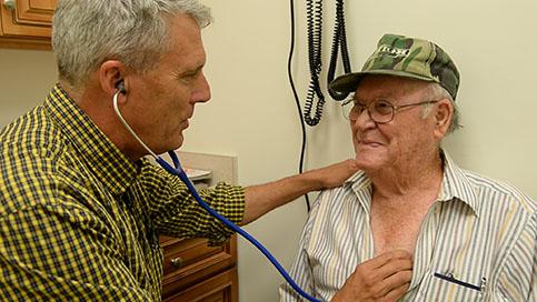 Dr. Marsh examines patient.
