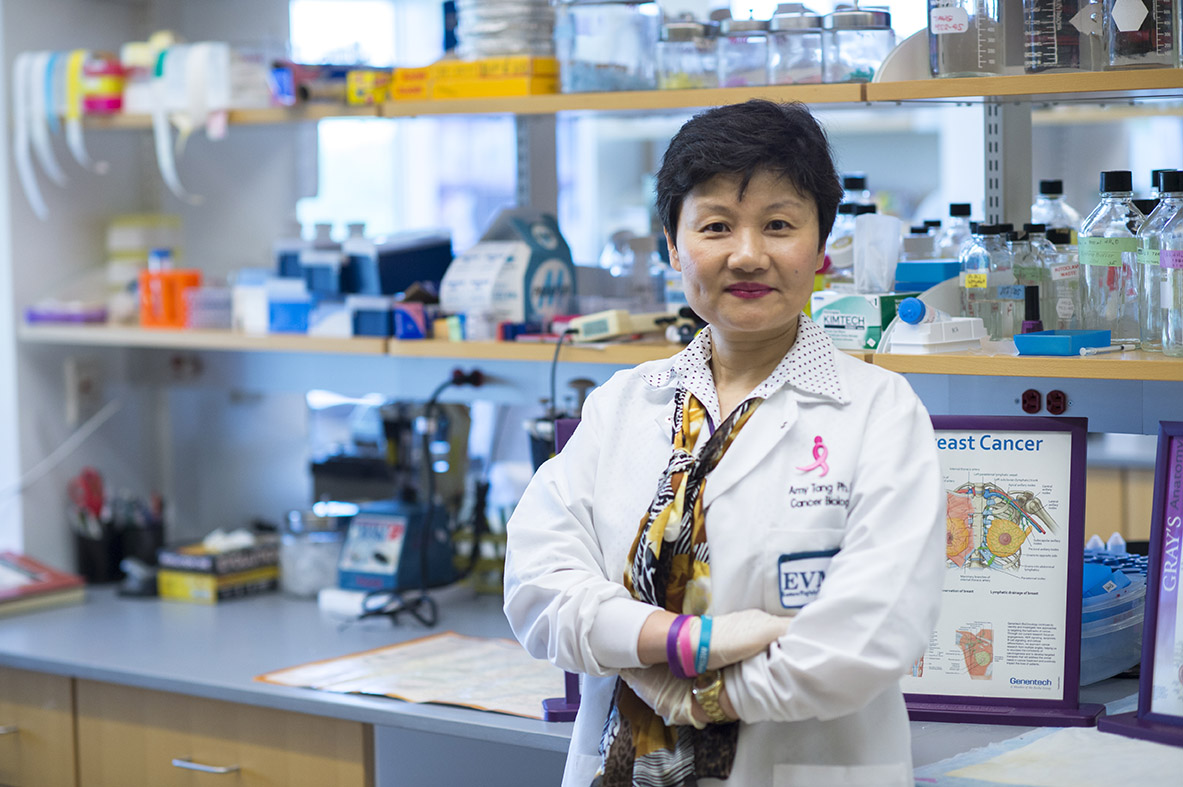 Dr. Tang standing in her Mircrobiology and Molecular Cell Biology Lab
