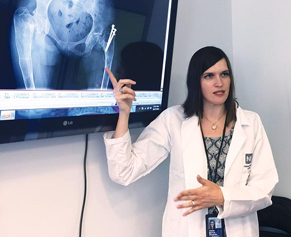 Dr. Alison Boyce lectures with use of an X-ray