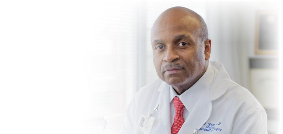 Dr. L.D. Britt in lab coat