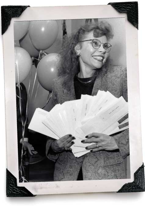 Woman holding Match Day envelopes.
