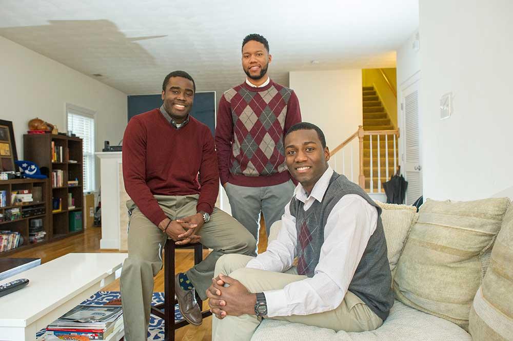 Gerry Ovide, Jelani Williams and Joshua Ononuju in their apartment.