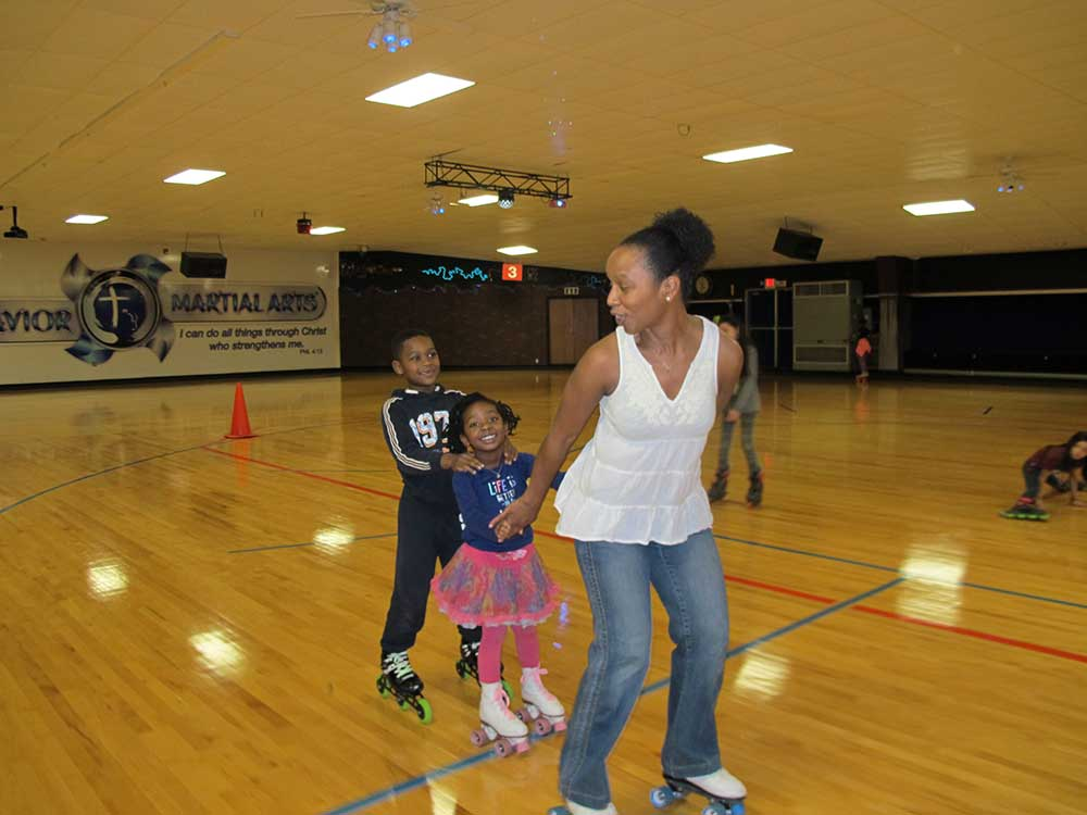 Dr. Salkey pulls her children behind her as she skates.