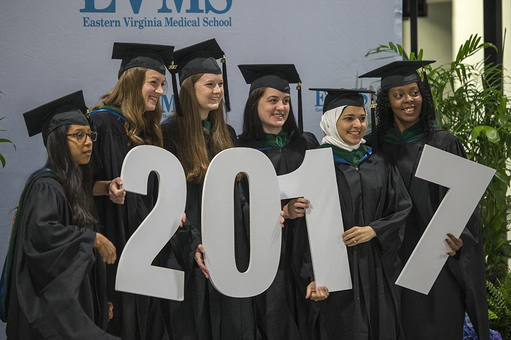Graduates holding '2017' sign