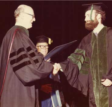 A graduate receives his diploma